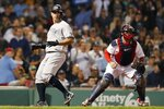 New York Yankees' Gary Sanchez, left, scores past Boston Red Sox's Christian Vazquez on a single by DJ LeMahieu during the fifth inning of a baseball game, Sunday, Sept. 26, 2021, in Boston. (AP Photo/Michael Dwyer)