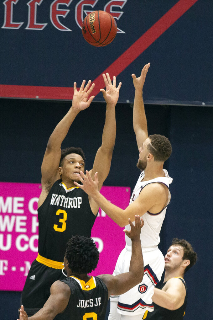 Saint Mary's guard Jordan Ford (3) puts up a last-second shot over Winthrop guard Micheal Anumba (3) that would have tied the game, during the second half of an NCAA college basketball game, Monday, Nov. 11, 2019 in Moraga, Calif. Ford's shot missed, and Winthrop upset 18th-ranked Saint Mary's 61-59. (AP Photo/D. Ross Cameron)