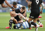 New Zealand's Beauden Barrett is tackled by Argentina's Pablo Matera during the Tri-Nations rugby test between Argentina and New Zealand at Bankwest Stadium, Sydney, Australia, Saturday, Nov.14, 2020. (AP Photo/Rick Rycroft)