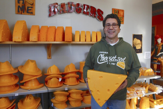 This Jan. 16, 2020 photo taken in Milwaukee shows Ralph Bruno, who invented the yellow wedge cheesehead in 1987 from his mother's couch stuffing. It has since become a symbol of pride, particularly for Wisconsin sports fans and residents.  Foamation, Inc. moved into a new location in 2016 and soon started tours where people can make their own cheeseheads or other foam products.  (AP Photo/Carrie Antlfinger)