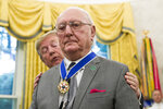 President Donald Trump presents the Presidential Medal of Freedom to former NBA basketball player and coach Bob Cousy, of the Boston Celtics, during a ceremony in the Oval Office of the White House, Thursday, Aug. 22, 2019, in Washington. (AP Photo/Alex Brandon)