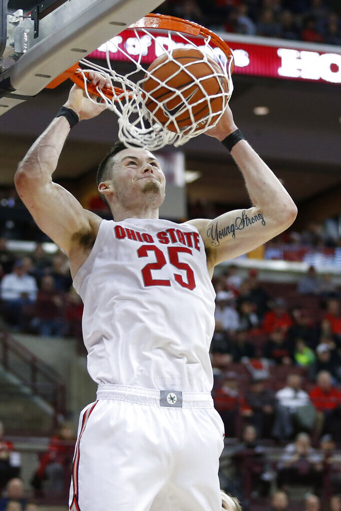 Ohio State's Kyle Young dunks the ball against Purdue during the second half of an NCAA college basketball game Saturday, Feb. 15, 2020, in Columbus, Ohio. Ohio State beat Purdue 68-52. (AP Photo/Jay LaPrete)