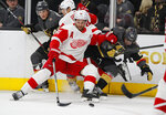 Detroit Red Wings center Frans Nielsen (51) vies for the puck with Vegas Golden Knights center Cody Eakin (21) during the second period of an NHL hockey game Saturday, March 23, 2019, in Las Vegas. (AP Photo/John Locher)