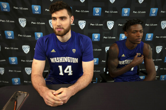 Washington's Sam Timmins, left, and Nahziah Carter speak during the Pac-12 NCAA college basketball media day, in San Francisco, Tuesday, Oct. 8, 2019. (AP Photo/D. Ross Cameron)