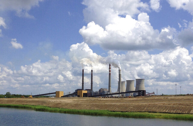 FILE - In a June 3, 2014, photo, the Paradise Fossil Plant stands in Drakesboro Ky. (AP Photo/Dylan Lovan, File)