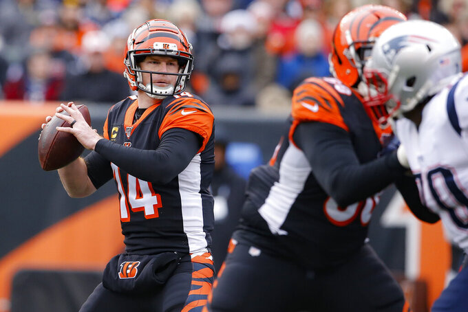 Cincinnati Bengals quarterback Andy Dalton (14) passes in the first half of an NFL football game against the New England Patriots, Sunday, Dec. 15, 2019, in Cincinnati. (AP Photo/Gary Landers)