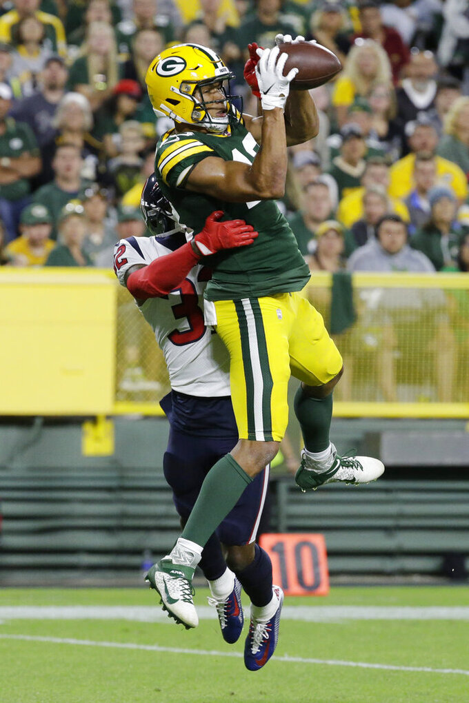 Green Bay Packers wide receiver Allen Lazard catches a pass for a touchdown while being covered by Houston Texans cornerback Lonnie Johnson during the second half of an NFL preseason football game Thursday, Aug. 8, 2019, in Green Bay, Wis. (AP Photo/Mike Roemer)