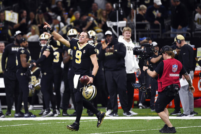New Orleans Saints quarterback Drew Brees (9) celebrates his touchdown pass to tight end Josh Hill, which broke the NFL record for career touchdown passes, surpassing Peyton Manning, in the second half of an NFL football game against the Indianapolis Colts in New Orleans, Monday, Dec. 16, 2019. (AP Photo/Bill Feig)