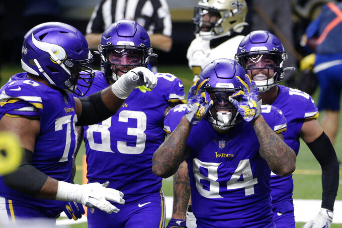 Minnesota Vikings tight end Irv Smith (84)celebrates his touchdown reception in the second half of an NFL football game against the New Orleans Saints in New Orleans, Friday, Dec. 25, 2020. (AP Photo/Butch Dill)