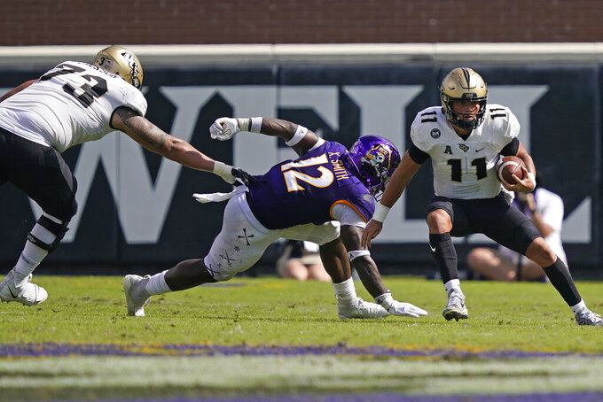 Central Florida quarterback Dillon Gabriel (11) scrambles against East Carolina linebacker Xavier Smith (12) as Central Florida offensive lineman Samuel Jackson (73) defends during the second half of an NCAA college football game in Greenville, N.C., Saturday, Sept. 26, 2020. (AP Photo/Gerry Broome)