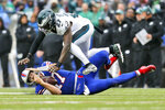 Buffalo Bills quarterback Josh Allen, bottom, calls time-out as he slides under Philadelphia Eagles' Malcolm Jenkins during the first half of an NFL football game, Sunday, Oct. 27, 2019, in Orchard Park, N.Y. (AP Photo/John Munson)