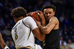 Georgia Tech forward James Banks III (1) and Pittsburgh guard Trey McGowens (2) tussle for the ball during the second half of an NCAA college basketball game Wednesday, Feb. 20, 2019, in Atlanta. Georgia Tech won 73-65. (AP Photo/Danny Karnik)