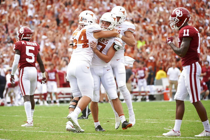 Texas kicker Cameron Dicker (17) celebrates with teammates after kicking the game-winning field goal in the closing seconds of the second half of an NCAA college football game against Oklahoma at the Cotton Bowl, Saturday, Oct. 6, 2018, in Dallas. Texas won 48-45. (AP Photo/Cooper Neill)