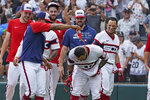 Chicago White Sox's Leury Garcia, center, gets douse with sports drink as the White Sox celebrates his walk-off home run during the ninth inning against the Boston Red Sox of a baseball game, Sunday, Sept. 12, 2021, in Chicago. (AP Photo/David Banks)