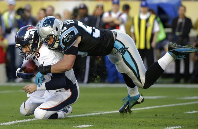 FLE - In this Feb. 7, 2016, file photo, Denver Broncos' Peyton Manning, left, is sacked by Carolina Panthers' Luke Kuechly during the first half of the NFL Super Bowl 50 football game in Santa Clara, Calif. Next Monday, April 6, 2020, the Hall of Fame and the NFL will announce the roster for the 2010-19 All-Decade team. Kuechly is a possible pick at linebacker. (AP Photo/Jae C. Hong, File)