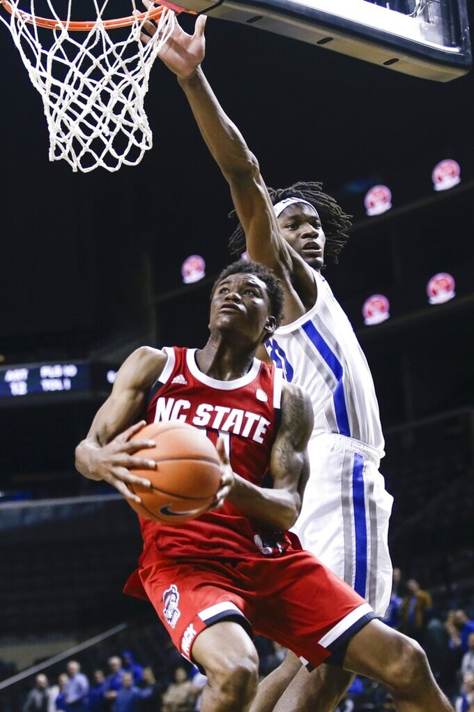 North Carolina State's Markell Johnson, left, drives past Memphis' Precious Achiuwa during the second half of an NCAA college basketball game in the Barclays Classic, Thursday, Nov. 28, 2019, in New York. (AP Photo/Frank Franklin II)