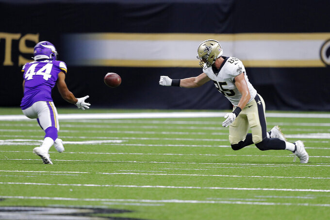 Minnesota Vikings defensive back Nathan Meadors (44) pulls in an interception for a touchdown on a bobbled pass by New Orleans Saints tight end Dan Arnold (85) in the second half of an NFL preseason football game in New Orleans, Friday, Aug. 9, 2019. (AP Photo/Bill Feig)