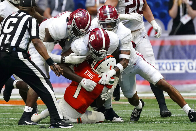 Miami quarterback D'Eriq King (1) is sacked by Alabama's Phidarian Mathis (48), Will Anderson Jr. (31) and Malachi Moore (13) during the second half of an NCAA college football game Saturday, Sept. 4, 2021, in Atlanta. (AP Photo/John Bazemore)