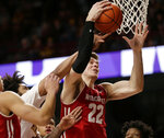 Wisconsin forward Ethan Happ (22) grabs a rebound from Minnesota forward Jordan Murphy during the first half of an NCAA college basketball game Wednesday, Feb. 6, 2019, in Minneapolis. (AP Photo/Andy Clayton-King)