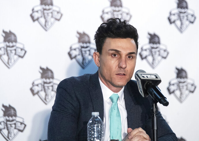 In this Jan. 8, 2020, photo, New York Liberty's general manager Jonathan Kolb speaks to reporters during a news conference at Barclays Center in New York. Kolb knew that he and first-year coach Walt Hopkins would have to make some tough decisions on the team's roster this year. He just didn't think they'd have to do it so quickly and without seeing players compete on the court in training camp. The WNBA and the players' union decided that teams would have to get their rosters under the salary cap by Tuesday, May 26, so that the players could start getting paid on June 1. (AP Photo/Mary Altaffer)