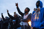 Demonstrators gather during a protest in response to the shooting death of Daunte Wright outside the Brooklyn Center Police Department, Thursday, April 15, 2021, in Brooklyn Center, Minn.  (AP Photo/John Minchillo)