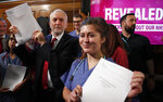 Britain's Labour party leader Jeremy Corbyn poses with documents after his speech in London, England, Wednesday, Nov. 27, 2019, ahead of the general election on Dec. 12. (AP Photo/Frank Augstein)
