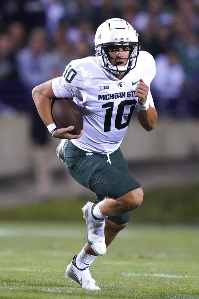 Michigan State quarterback Payton Thorne runs with the ball during the first half of the team's NCAA college football game against Northwestern in Evanston, Ill., Friday, Sept. 3, 2021. (AP Photo/Nam Y. Huh)