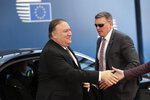 U.S. Secretary of State Mike Pompeo, left, arrives for a meeting with European foreign ministers at the Europa building in Brussels, Monday, May 13, 2019. The EU backers of the Iran nuclear deal meet with U.S. Secretary of State Mike Pompeo to discuss ways to keep the pact afloat. (AP Photo/Francisco Seco)