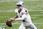 Las Vegas Raiders quarterback Derek Carr (4) works in the pocket against the Atlanta Falcons during the second half of an NFL football game, Sunday, Nov. 29, 2020, in Atlanta. (AP Photo/John Bazemore)