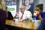 Britain's Prime Minister Boris Johnson speaks to mental health professionals as he visits Watford General hospital, England, Monday Oct. 7, 2019. The UK government has pledged billions for new hospital projects across England under plans devised up by Health Secretary Matt Hancock. (Peter Summers/Pool via AP)