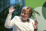 Chancellor Angela Merkel (CDU) waves at the 37th German Protestant Church Congress in Dortmund, Saturday, June 22, 2019. The meeting of Protestant Christians is also intended to send a signal against the division of society, xenophobia and a brutalization of language. (Bernd Thissen/dpa via AP)