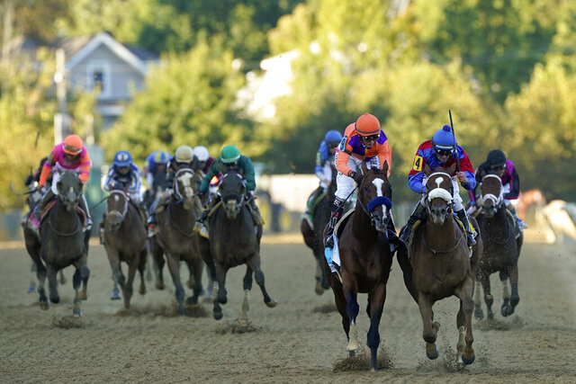 Swiss Skydiver (4), ridden by Robby Albarado, leads Authentic (9), ridden by John Velazquez, to win  the 145th Preakness Stakes horse race at Pimlico Race Course, Saturday, Oct. 3, 2020, in Baltimore. (AP Photo/Steve Helber)