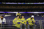Fans wear ponchos after returning to their seats following a delay for severe weather during the first quarter of an NCAA college football game between Washington and California, Saturday, Sept. 7, 2019, in Seattle. (AP Photo/Ted S. Warren)