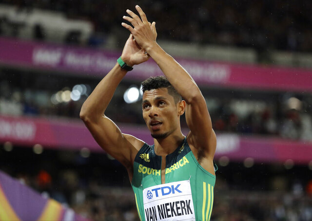 FILE - In this Wednesday, Aug. 9, 2017 file photo, South Africa's Wayde van Niekerk applauds after finishing a Men's 200m semifinal during the World Athletics Championships in London.  Olympic 400-meter champion Wayde van Niekerk is competing again after more than two years out with a career-threatening knee injury, it was reported on Tuesday, Feb. 25, 2020. Van Niekerk ran at two low-level meets over the past week in Bloemfontein, South Africa, and came through them without any problems. (AP Photo/David J. Phillip, File)
