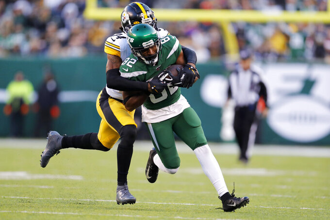 New York Jets wide receiver Jamison Crowder (82) runs with the ball under pressure from Pittsburgh Steelers strong safety Terrell Edmunds (34) in the second half of an NFL football game, Sunday, Dec. 22, 2019, in East Rutherford, N.J. (AP Photo/Adam Hunger)
