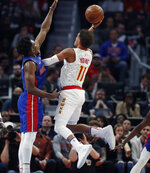 Atlanta Hawks guard Trae Young (11) shoots as Detroit Pistons guard Langston Galloway defends during the first half of an NBA basketball game Thursday, Oct. 24, 2019, in Detroit. (AP Photo/Carlos Osorio)