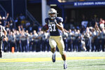 Navy wide receiver Jayden Umbarger (87) runs the ball during the first half of an NCAA college football game against Marshall, Saturday, Sept. 4, 2021, Annapolis, Md. (AP Photo/Terrance Williams)