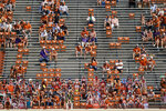 Fans wear face masks and use social distancing during the first half of an NCAA college football game between Texas and TCU, Saturday, Oct. 3, 2020, in Austin, Texas. (AP Photo/Eric Gay)