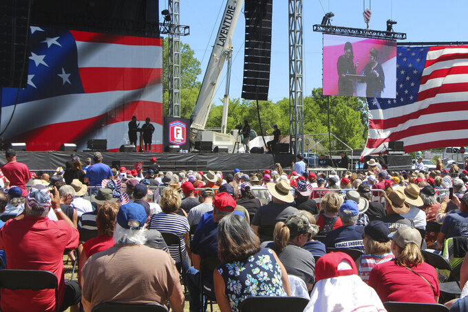 Diamond and Silk on stage at a rally organized by Mike Lindell in New Richmond, Wis., on Saturday, June 12, 2021, where he and other speakers disputed the results of the 2020 election. They frequently appeared at former President Donald Trump's campaign rallies as well. For a few hours last weekend, thousands of Donald Trump's loyal supporters came together under the blazing sun in a field in western Wisconsin to live in an alternate reality where the former president was still in office — or would soon return.(AP Photo/Jill Colvin)