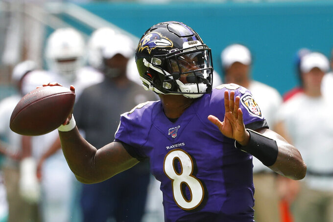FILE - In this Sept. 8, 2019, file photo, Baltimore Ravens quarterback Lamar Jackson (8) looks to pass the ball during the first half at an NFL football game against the Miami Dolphins, in Miami Gardens, Fla. The Browns and Baltimore Ravens meet on Sunday, Sept. 29. (AP Photo/Wilfredo Lee, File)