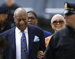 Bill Cosby, left, arrives with his wife, Camille, for his sexual assault retrial, Tuesday, April 24, 2018, at the Montgomery County Courthouse in Norristown, Pa. (AP Photo/Matt Slocum)