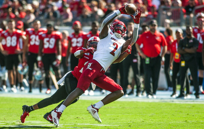 Louisville wide receiver Devante Peete (2) catches a pass while guarded by Western Kentucky defensive back Beanie Bishop (29) during an NCAA college football game, Saturday, Sept. 14, 2019, in Bowling Green, Ky. (Austin Anthony/Daily News via AP)