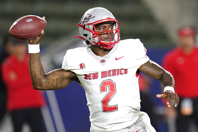 New Mexico quarterback Terry Wilson (2) throws a pass during the first half of an NCAA football game against the San Diego State Saturday, Oct. 9, 2021, in Carson, Calif. (AP Photo/Ashley Landis)