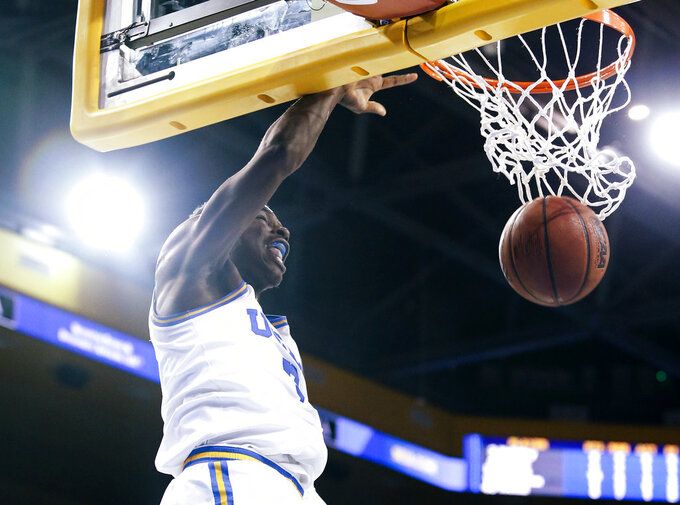 UCLA guard Aaron Holiday dunks against Washington during the second half of an NCAA college basketball game in Los Angeles, Sunday, Dec. 31, 2017. UCLA won 74-53. (AP Photo/Ringo H.W. Chiu)