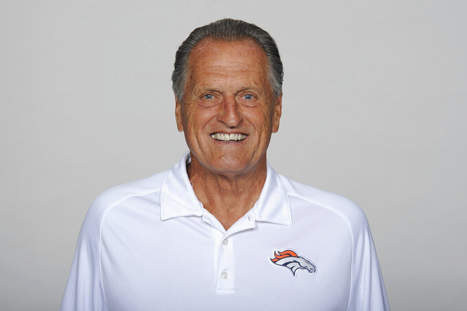 FILE - This is a 2013 file photo showing Alex Gibbs of the Denver Broncos NFL football team. Gibbs, the innovative offensive line coach whose zone-blocking scheme helped lead the Denver Broncos to back-to-back Super Bowl triumphs in the 1990s, has died at age 80, the team said. The team said Gibbs died Monday, July 12, 2021,  from complications of a stroke with family by his side in his Phoenix home. (AP Photo/File)