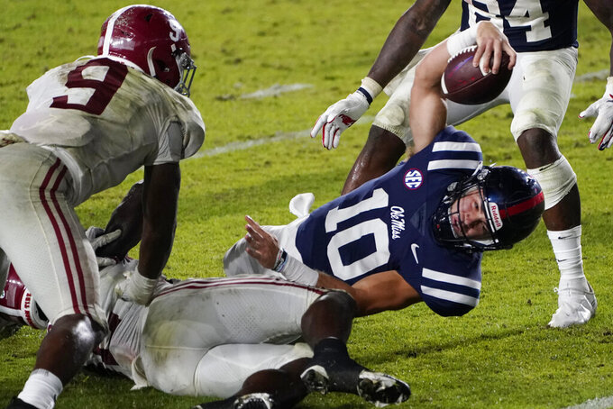 Mississippi quarterback John Rhys Plumlee stretches toward the goal line, but is stopped short, as Alabama defensive back Jordan Battle (9) defends during the second half of an NCAA college football game in Oxford, Miss., Saturday, Oct. 10, 2020. Alabama won 63-48. (AP Photo/Rogelio V. Solis)