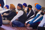 Members of the Sikh Coalition gather at the Sikh Satsang of Indianapolis in Indianapolis, Saturday, April 17, 2021 to formulate the groups response to the shooting at a FedEx facility in Indianapolis that claimed the lives of four members of the Sikh community.   A gunman killed eight people and wounded several others before  taking his own life in a late-night attack at a FedEx facility near the Indianapolis airport. (AP Photo/Michael Conroy)