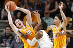 Tennessee forward John Fulkerson (10) loses his headband as he grabs a rebound in front of Vanderbilt guard Saben Lee (0) during the first half of an NCAA college basketball game Saturday, Jan. 18, 2020, in Nashville, Tenn. At right is Tennessee forward Olivier Nkamhoua. (AP Photo/Mark Humphrey)