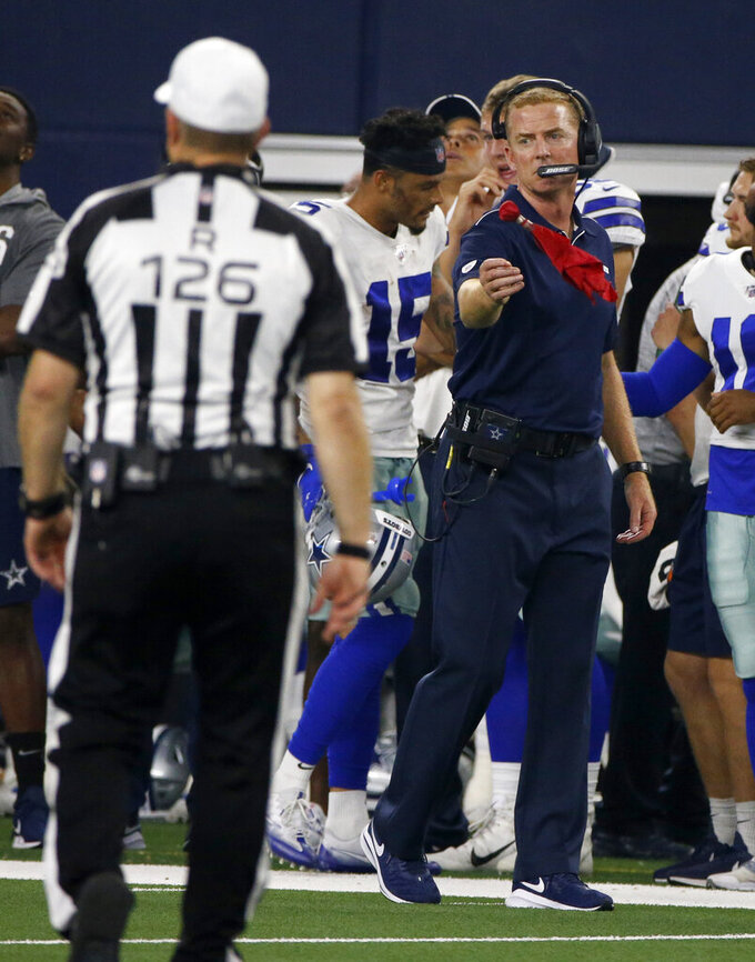Referee Brad Rogers (126) looks on as Dallas Cowboys head coach Jason Garrett throws a challenge flag in the first half of a preseason NFL football game against the Tampa Bay Buccaneers in Arlington, Texas, Thursday, Aug. 29, 2019. (AP Photo/Michael Ainsworth)
