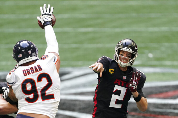 Chicago Bears defensive end Brent Urban (92) deflects a Atlanta Falcons quarterback Matt Ryan pass during the second half of an NFL football game, Sunday, Sept. 27, 2020, in Atlanta. (AP Photo/John Bazemore)